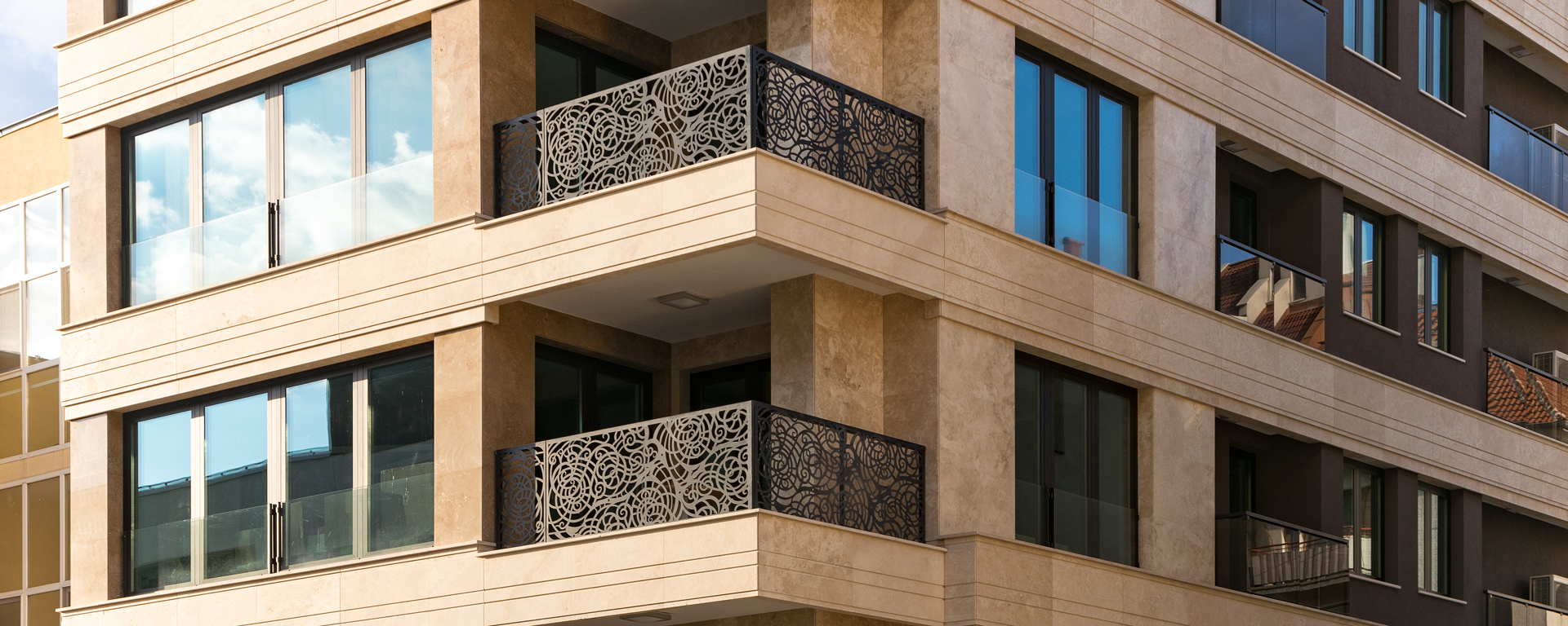 residential building ventilated façade with travertine | bulkam decor